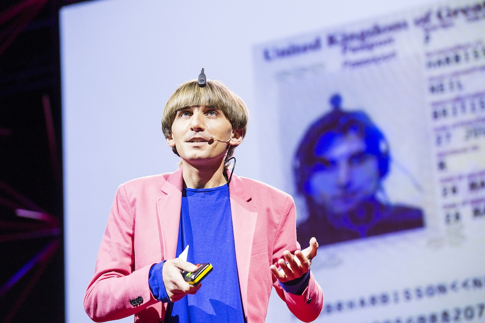 cyborg-neil-harbisson-showing-his-uk-passport-which-recognizes-him-as-part-machine