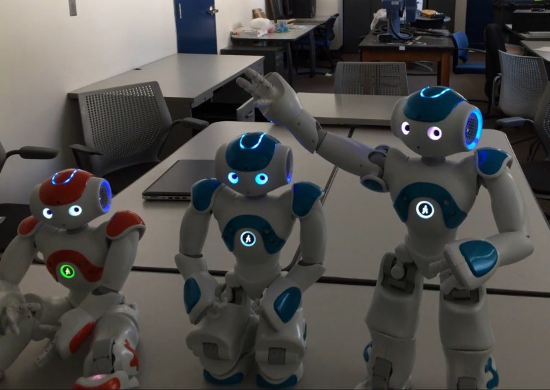 "In a July 2015 experiment led by Dr. Selmer Bringsjord of New York's Rensselaer Polytechnic Institute, three robots were presented with a variant of the classic ""wise men"" riddle. Two out of three were programmed to be mute. All three were informed of this fact, and asked to deduce which one was not mute. The robot on the right stood up, said ""I don't know,"" then corrected itself, realizing that because it had spoken out loud it must be the non-mute one. The researchers describe this experiment as a ""mathematically verifiable awareness of the self,"" similar in purpose to the Mirror Test. But can we verify whether or not the robot has a subjective experience of consciousness? (screenshot from <a href=""https://www.youtube.com/watch?v=MceJYhVD_xY"">YouTube</a>, <a href=""https://animalpeopleforum.org/beyondhuman/copyright-and-fair-use/"">fair use</a>)"